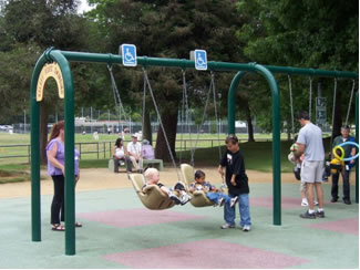 Seating harness allows children with less muscular control to enjoy the swingsets